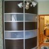 Радиусный шкаф-купе с фасадами покрытыми шпоном